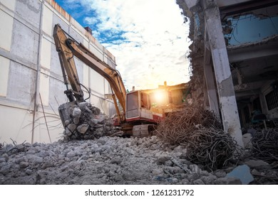 Large Construction Machinery breaking old buildings.