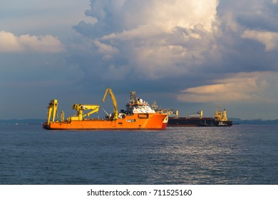 Large container cargo offshore ship in the sea.