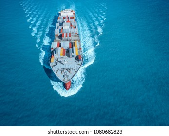 Large container ship is coming to the port full loaded with containers and cargo