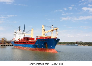 large container ship leaving harbour