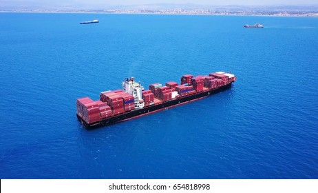 Large Container ship on the open sea isolated - aerial
