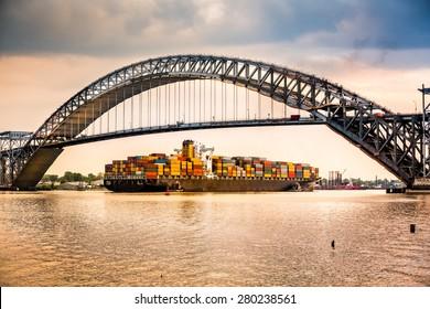 Large container ship passes under Bayonne Bridge, NJ en route towards Newark Harbor