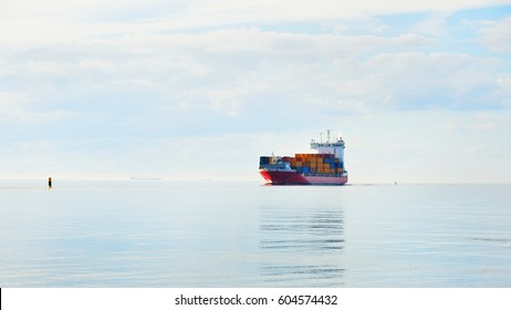 Large container ship sailing in still sea water