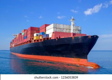 Large container ship at sea - Low angle aerial image.