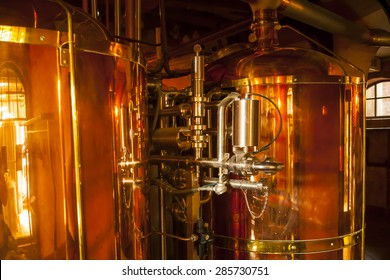 Large, copper container for whisky, many reflections of light.