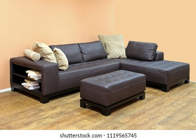 Large corner leather sofa with book case on the edge