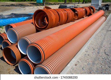 large corrugated brown polyethylene pipe for water supply, urban sewer pipe with high chemical resistance, pipeline repair