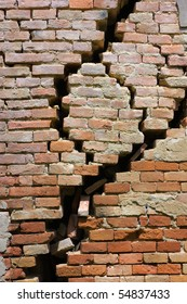 large crack in the house in ruins - wall of house destroyed during earthquake