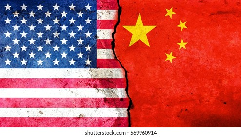 A large crack in the wall. USA flag. China's flag.