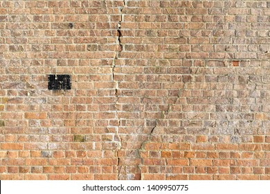 Large cracks in a brick wall due to subsidence