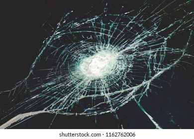 large cracks on the glass from impact, retro toned, background, texture