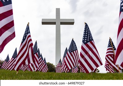 Large cross with several American Flags on Memorial Day in Houston TX