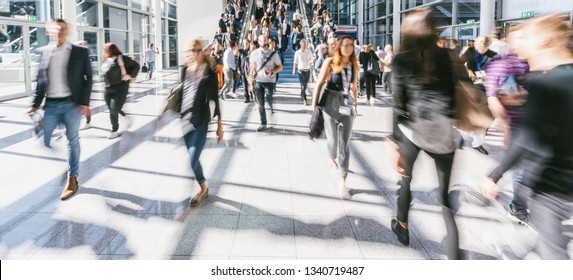 large Crowd of anonymous people walking at the trade show