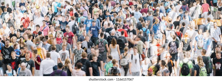 large crowd of  blurred people at a trade show