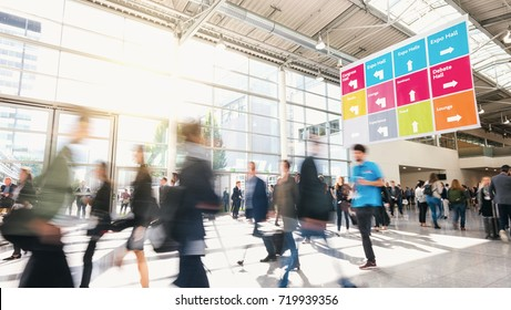 Large crowd of business people walking at a trade fair