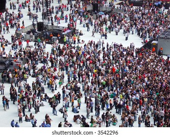 Large crowd of people waiting for a gig to start