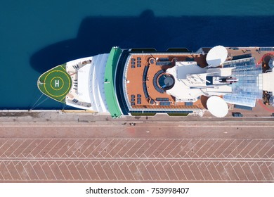 Large cruise ship docked at port - Top down aerial view