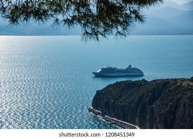 Large cruise ship waiting by the shores in  Mediterranean region