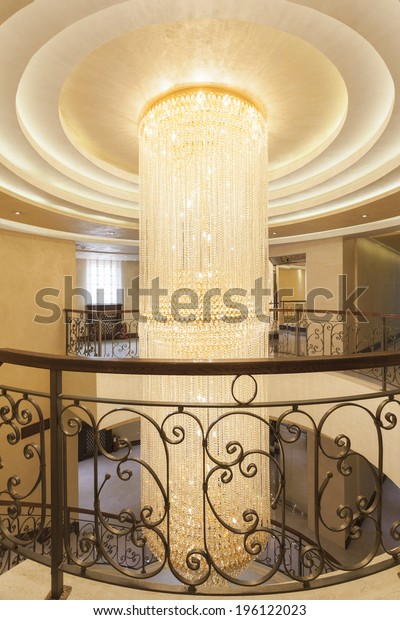 Large crystal chandelier in hotel lobby