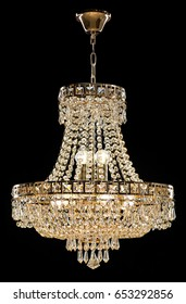 Large crystal chandelier isolated on black background.