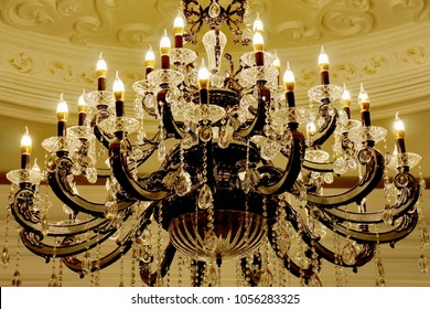 large crystal chandelier vintage glowing in the form of candelabra candlesticks and candlesticks with crystal stones