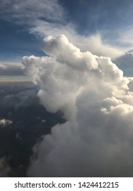 A large cumulonimbus cloud viewed from an airplane.