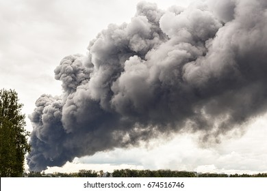 large dark clouds of smoke from fire as background/dark big clouds of smoke from a fire at the plant