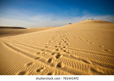 Large desert with wrinkles on the floor on a sunny day.