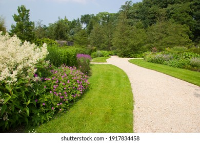 large designed landscape garden with special plants, furniture and greenery