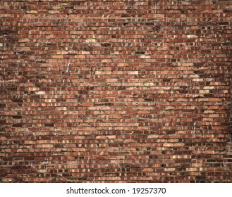 large and detailed brick wall, with multicolor bricks, and some splashes of white paint