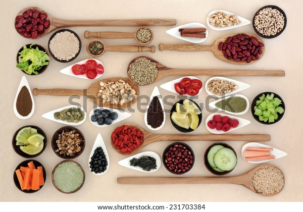 Large diet and weight loss super food selection in bowls and wooden spoons over mottled cream background.