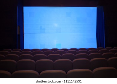 large digital blue screen in theater