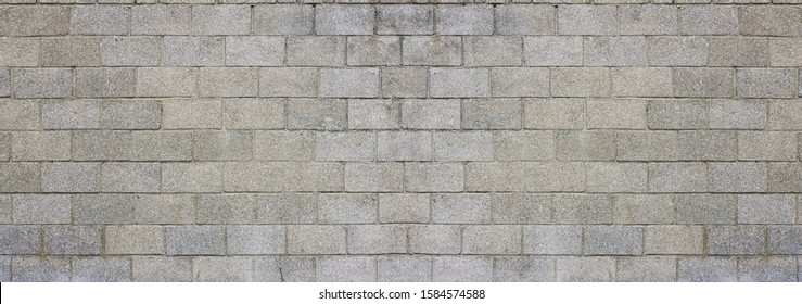 Large and dirty cinderblocks wall background or texture