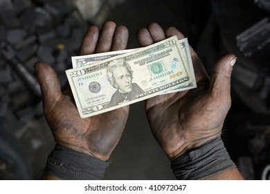 Large Dirty Man's Hands With Dollar Bills Lying On Them, In The Workshop – Stock Photo