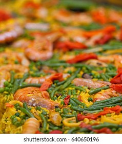 Large dish of Paella on a seafood market stall
