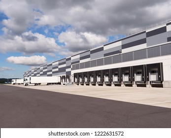 Large distribution and logistic warehouse. Row of Loading ramps.