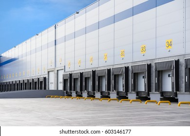 A large distribution warehouse with gates for loading goods