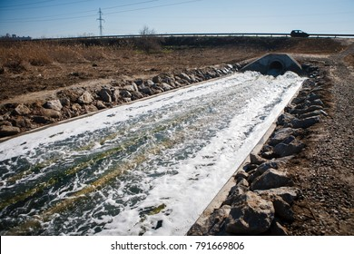 Large drainage sink with water under the road