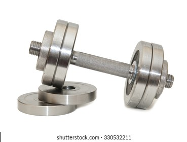 Large dumbbell and discs on a white background
