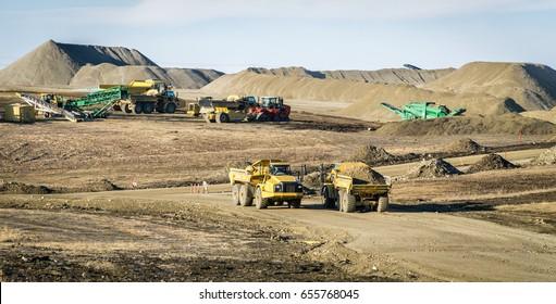 Large dump trucks on a road construction site