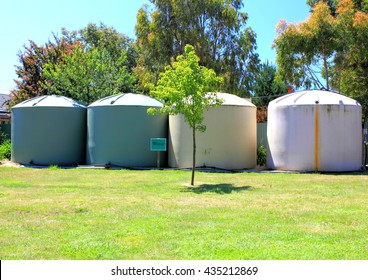 Large eco- friendly water storage tanks in suburban backyard