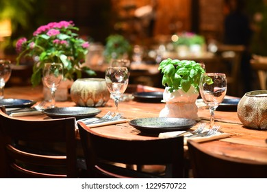 Large elegant wooden table in a rustic style, served for a celebration