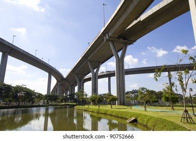 Large elevated traffic highway with pond