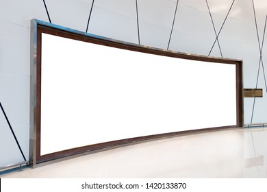 Large empty curved billboard on striped wall in hall