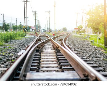 A large empty railroad fork. A lots of road junctions. at sunset. Railway station, Industrial logistic and transportation concept background,film tone vintage style,Select focus on center point