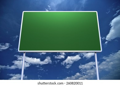 Large Empty Road Sign on Blue Cloudy Sky Background.