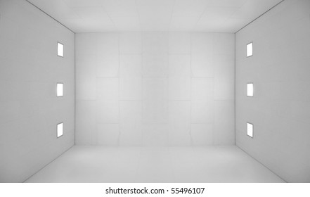 Large empty room with a wooden floor and white wooden tile walls with square lights on the ceiling and lots of open blank empty space.