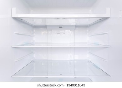 Large empty shelves in the refrigerator.