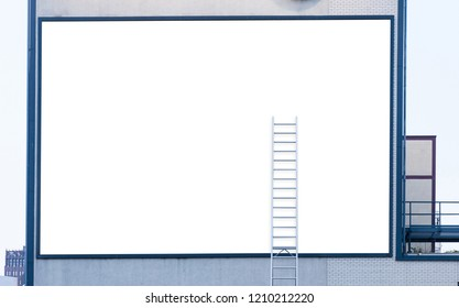 Large Empty white billboard with ladder on industrial building
