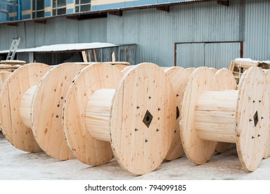 Large empty wooden coils. The new cable drums at the industrial area. Outdoors